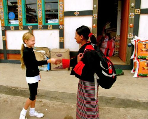 world traveling family making friends in Bhutan