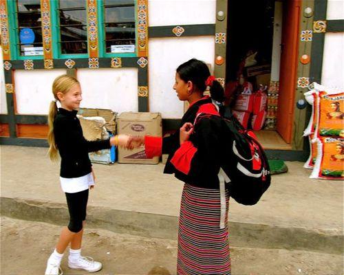world traveling family making friends in Bhutan