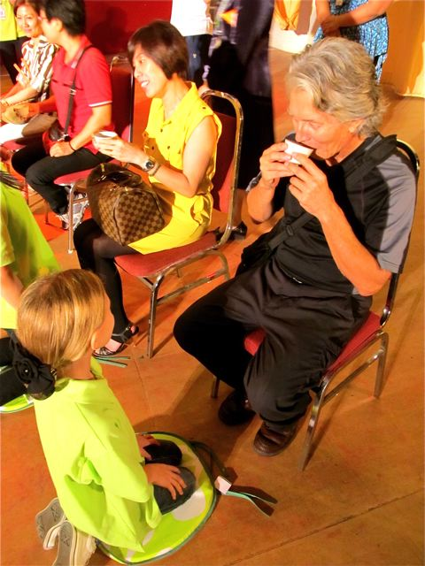 drinking the tea in the tea ceremony, child serves parent