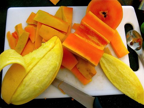 Making yummy mango and papaya chutney- cutting up the fruit