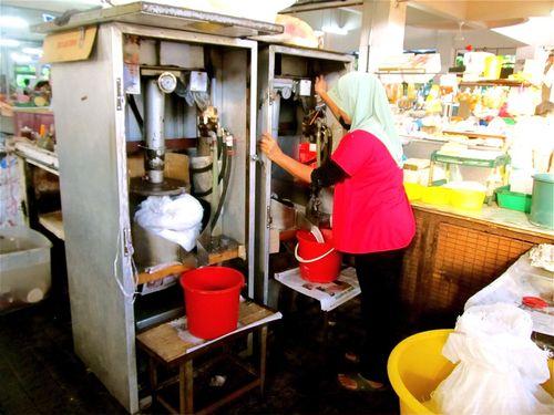 making coconut milk in Malaysia