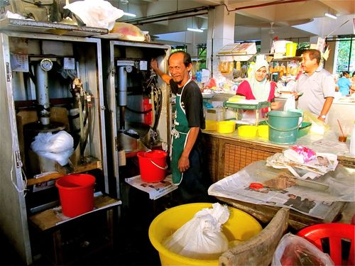 wet market in Penang selling freshly made coconut products