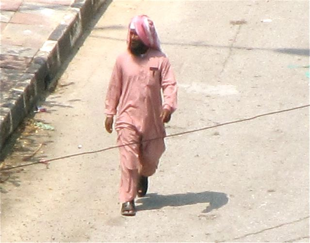 Man dressed in pink for Eid ul-Fitr Festival