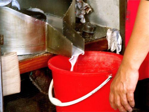 Making fresh coconut milk in Asia closeup