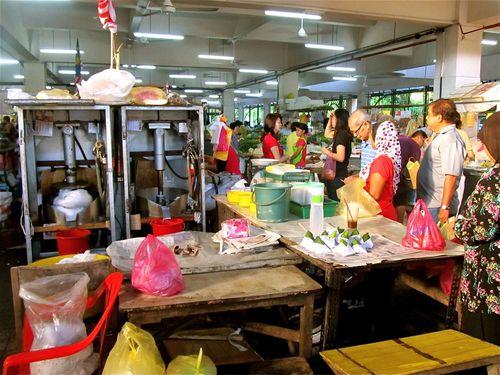 buying coconut milk in local market in Asia