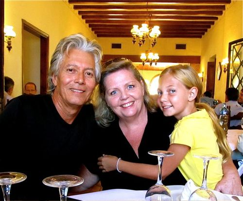 Happy around-the-world traveling family