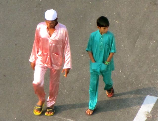 Malay father and son dressed in new clothes for Eid ul-Fitr Festival