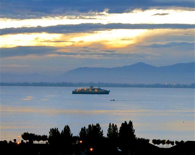 beautiful dawn, rising sun and cruise ship for morning inspiration
