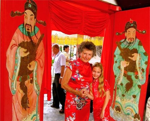 Grandma and child dressed in traditional Chinese dresses