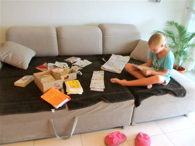 Our international student reading letters, cards, comics and care packages from home happily