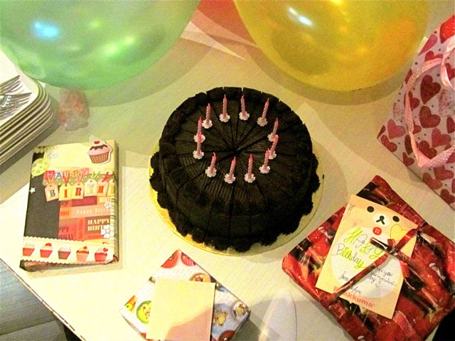 delicious birthday cake and presents