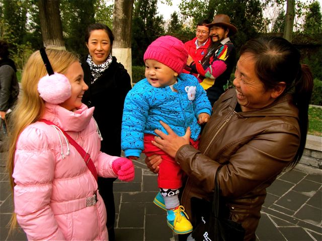 American blond child and Chinese baby make smile ambassadors