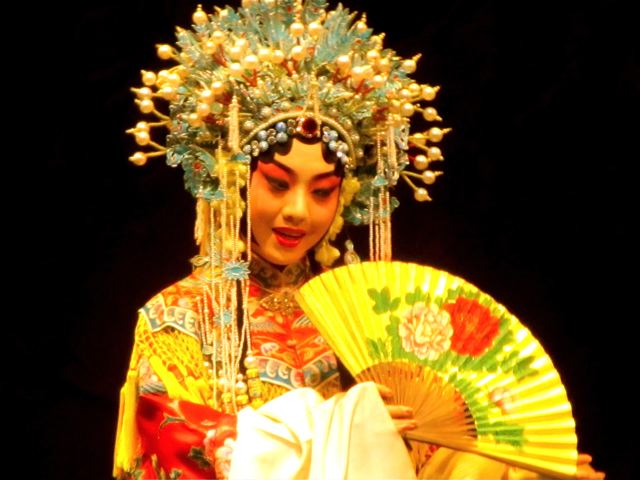Peking Opera in Beijing China - singing with fan