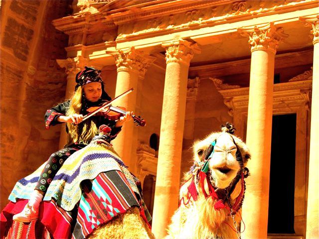 playing violin on a camel in Petra, Jordan