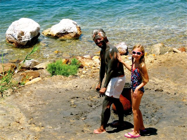 family travel means enioying the spa , mud and floating at the Dead Sea