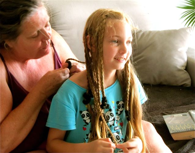 Mother daughter bonding - braiding hair into the Bo Derek look together