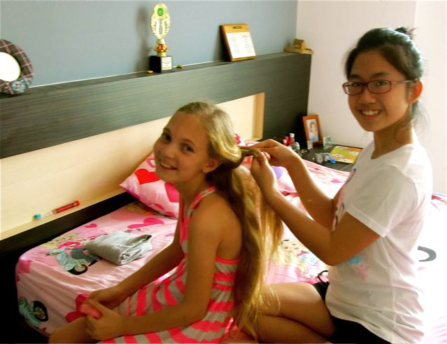 time to fix each others hair on a sleep over in Asia at our house