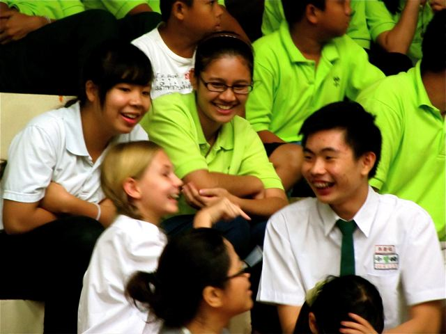 Our American daughter enjoying her friends at her Mandarin school in Asia