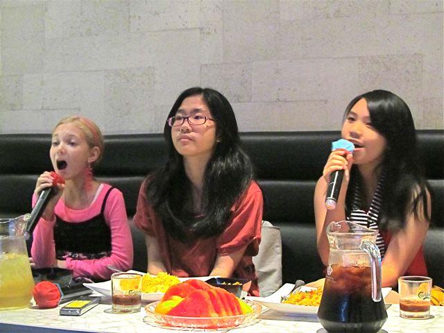 good friends singing karaoke together