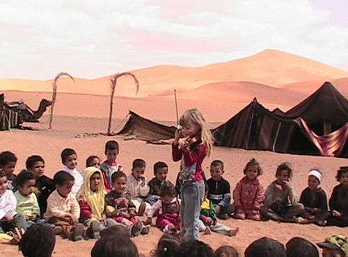 A 6 year old child doing volunteer work in Morocco's Sahara