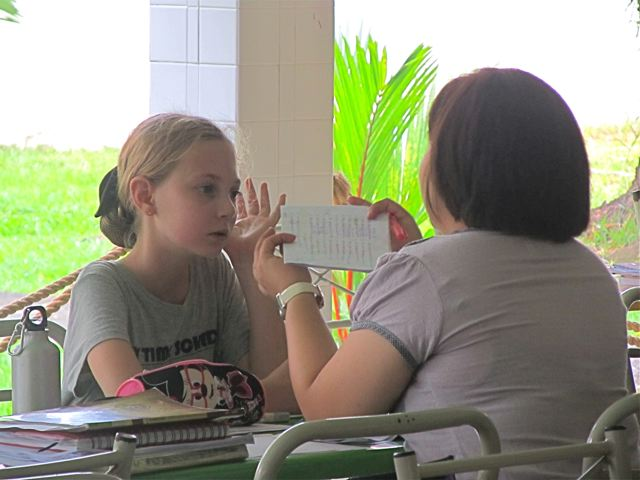 Doing after school tutoring with her Chinese teacher at her Mandarin shool in Asia - an American doing the Asian tuition route to raise scores and help learning