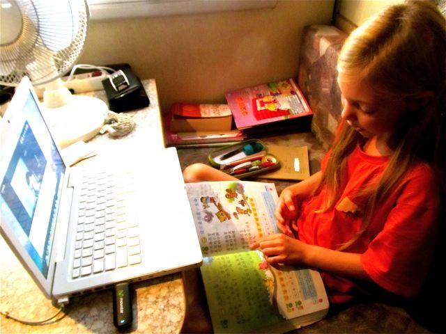 learning Mandarin in RV in Spain with teacher in Malaysia via skype webcam- homeschool or worldschooling a trilingual