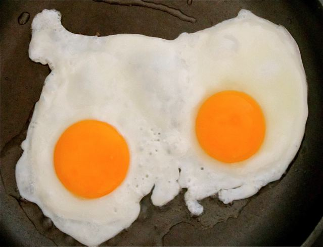 sunny side up eggs from pastured eggs - note the orange yolks