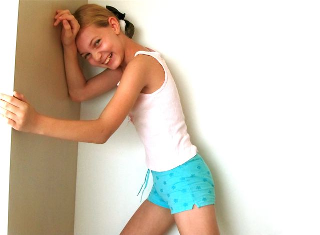 Almost teen model in size 12 months shorts and T-shirt