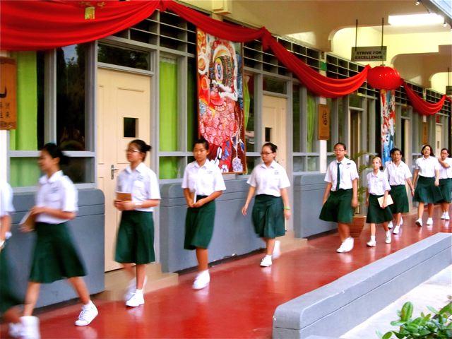Chinese girls in school uniforms at Mandarin school plus one American