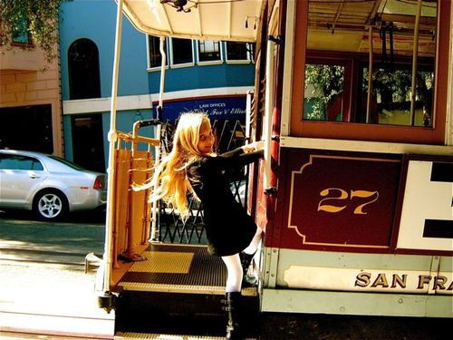 Cutie fashionista catching a cable car in SF