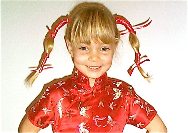 Our little blond trilingual in Chinese outfit - multilingual kid fun!
