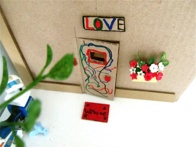 the door to her kids doll house she painted love and welcome