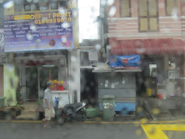 view from bus window in rainy downpour in Penang /no side walks