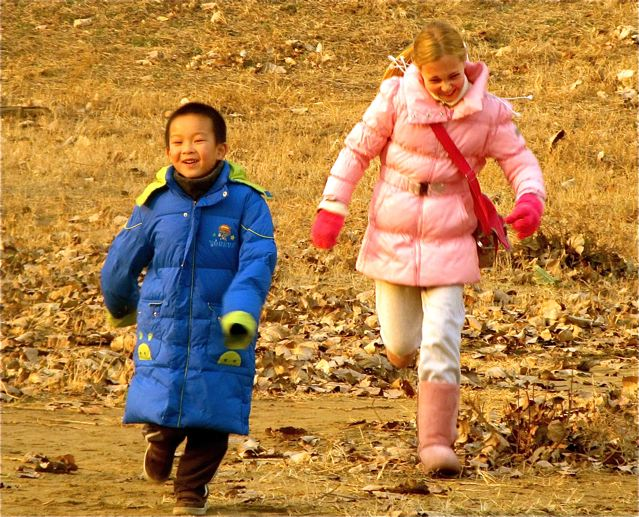 Two kids playing in Beijing park