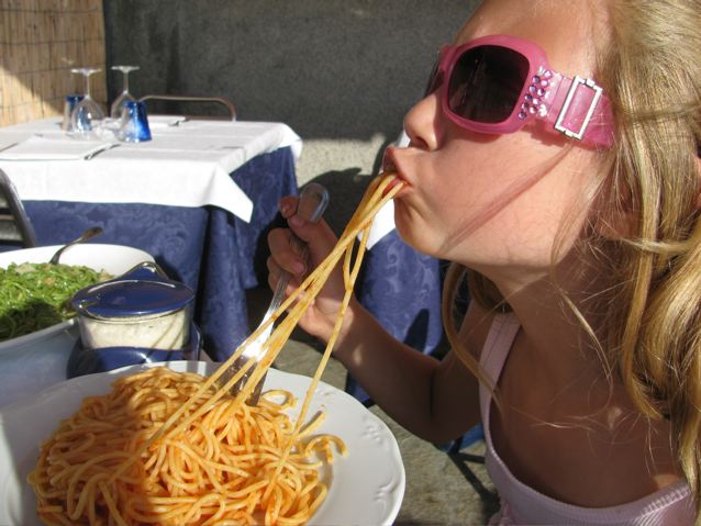 Yum! My girl enjoying spaghetti in Italy- funny!