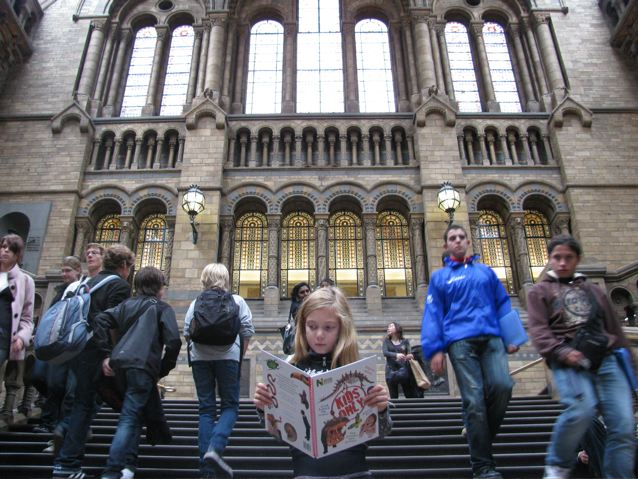 our tavel girl reading book at free museum in London
