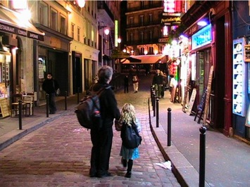 Backpacking dad and daughter exploring Paris at night