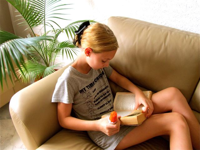 Reading a classic book while chomping on an organic carrot