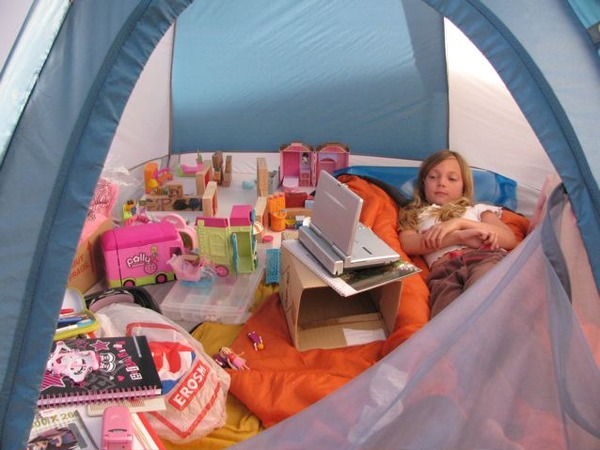 Camping Europe and a happy kid in her tent