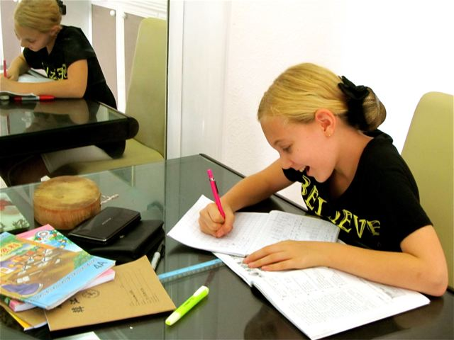 Self led homeschooling at the kitchen table...in Asia