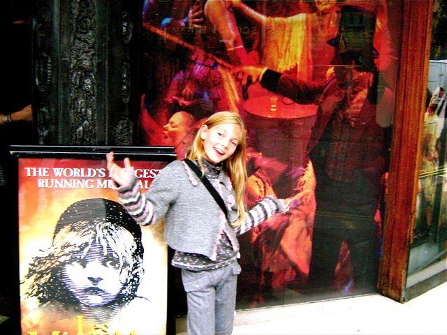 cute girl having a ball at Le Miz show London