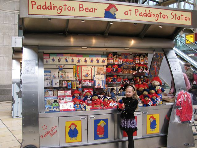 Our girl enjoying paddington bear in Paddington Station London