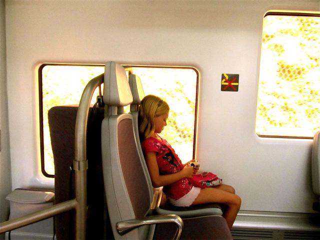 My girl riding the train to Barcelona, Spain