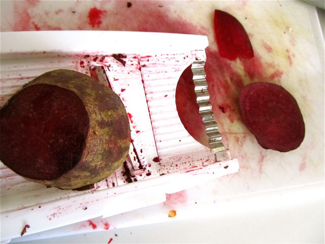 slicing beets with a mandolin