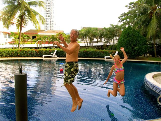 Father -Daughter relationships start by time together like this happy pool jump photo