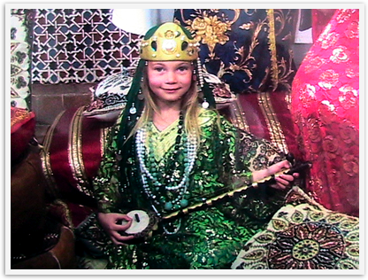 dressing up as a moorish princess adds to the living history of the Alahambra for this child