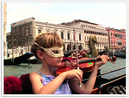 Gondola ride in Venice made extra special with a mask and violin