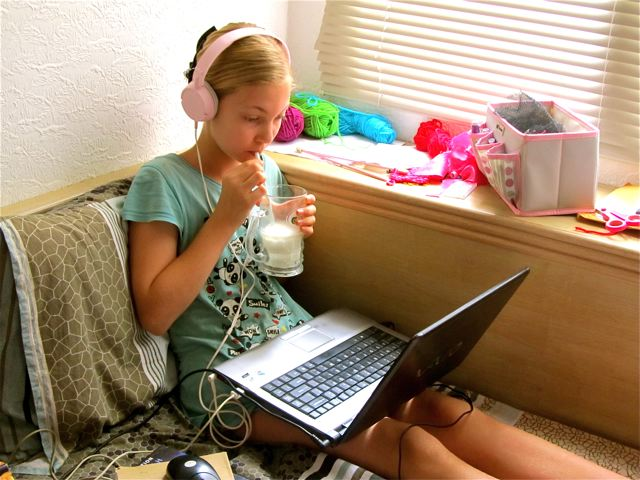 homeschool kid doing chemistry online and drinking raw milk