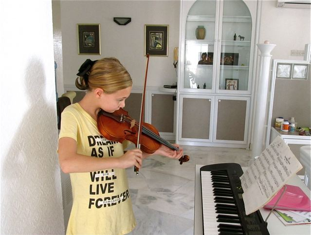 homeschool and traveling the world with a violin and piano means daily practice