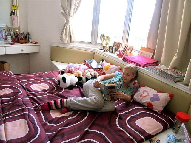 Homeschool almost teen - lazing in bed reading classics